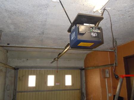 Systeme d 39 ouverture electrique pour porte de garage bourges for Porte de garage electrique